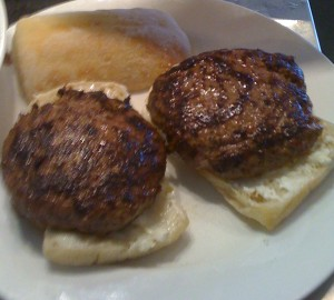Grill Tajima Wagyu burgers. Can use ciabatta bread or regular burger buns. Instead of buttering inside of sliced bread buns, spread s little of goat cheese.  Put grilled burger on top of sliced bread.