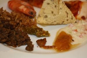 Melange of lamb briyani, chutney, tikka & rotina